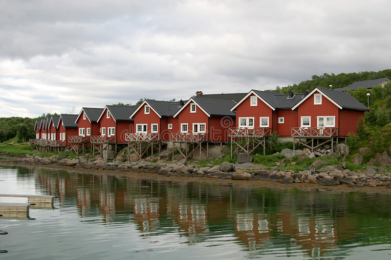 Reflecting rorbuer (cottages) royalty free stock image