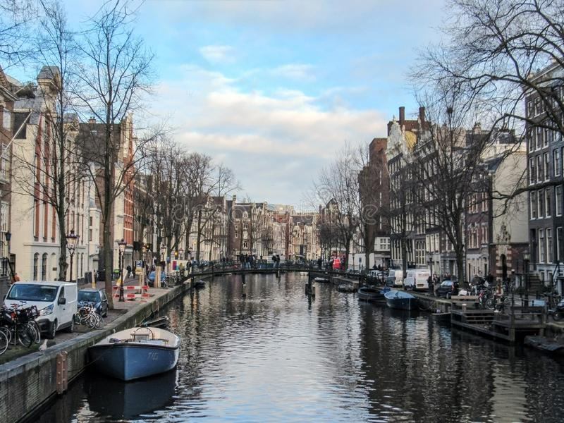 Reflection of Amsterdam famous duch traditional Flemish brick buildings on the canal in Holland, Netherlands stock photos