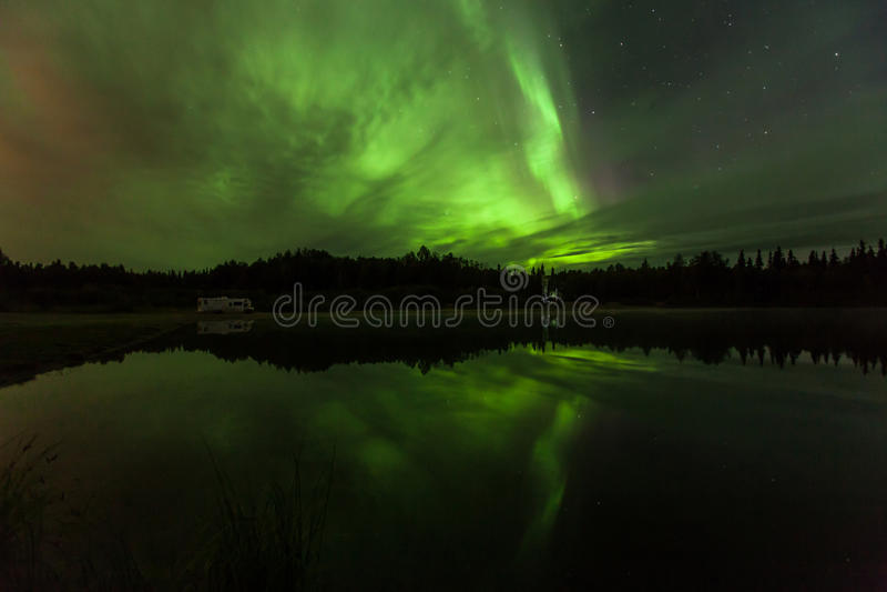Reflection of Aurora Borealis over Olnes pond in Fairbanks, Alaska royalty free stock photography