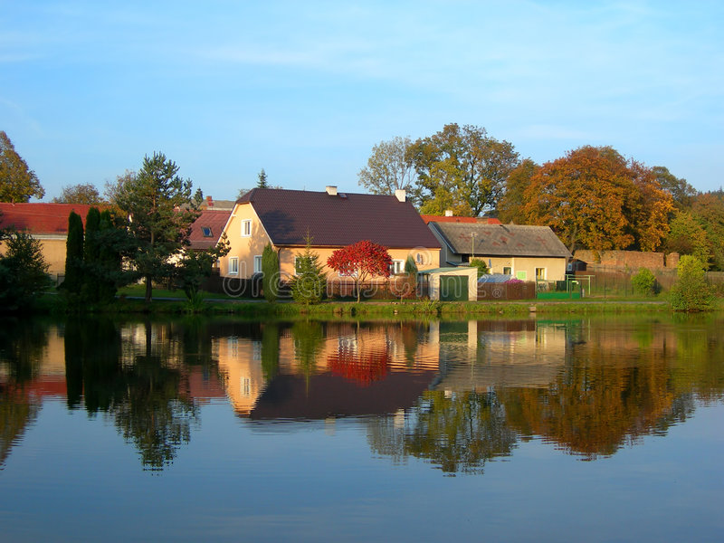 Reflection of a autumn village royalty free stock image