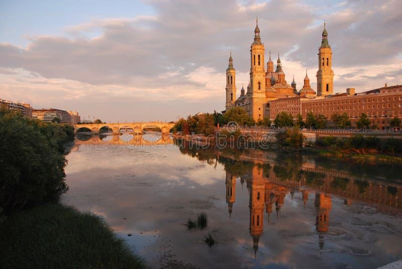 Reflection of El Pilar, Zaragoza,Spain. Reflection of the basilica of El Pilar on the Ebro River in Zaragoza, Spain stock photo