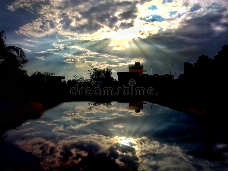 Reflection of beautiful and dramatic clouds. At noon. The reflection was made on mobile display stock photography