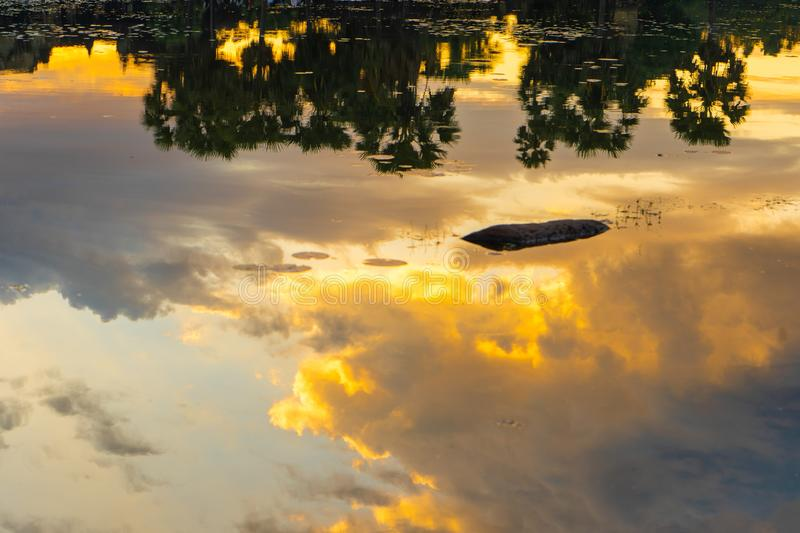 Reflection of beautiful sky on the water. Nature stock photos