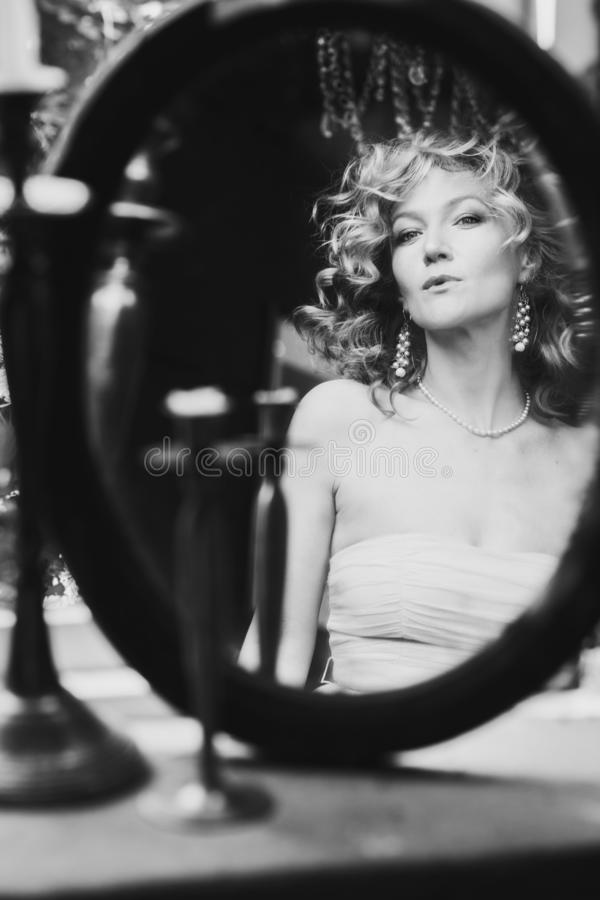 Reflection of beautiful woman in the mirror, BW shot royalty free stock images