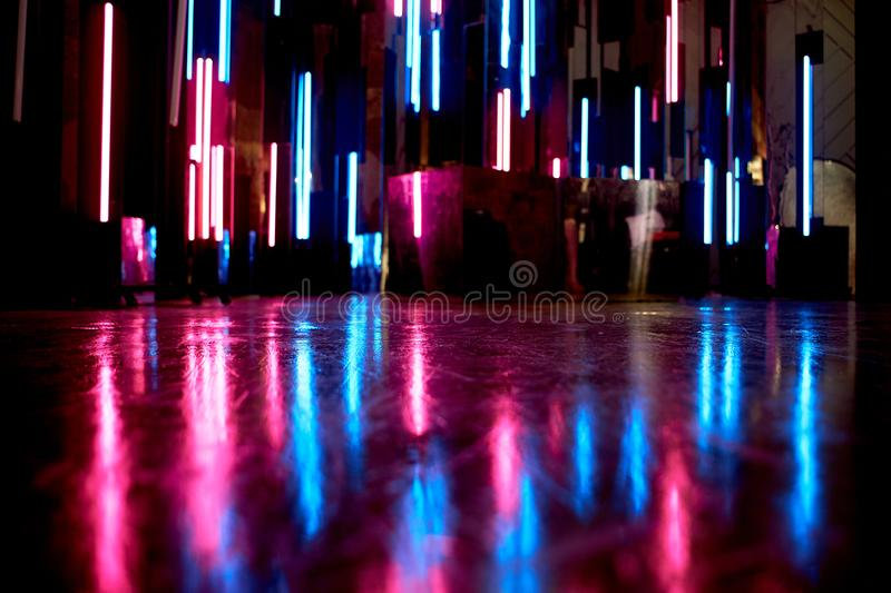 The reflection of blue and pink light at the surfaces. The atmosphere of the club, the parties.Twilight stock images