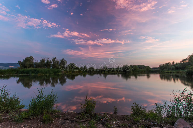 Reflection of blue-purple sky at sunset. On the surface of the water stock images