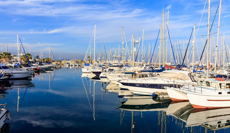Reflection of boats laying in a marina at Larnaca, Cyprus. Blue sky and sea background. stock image