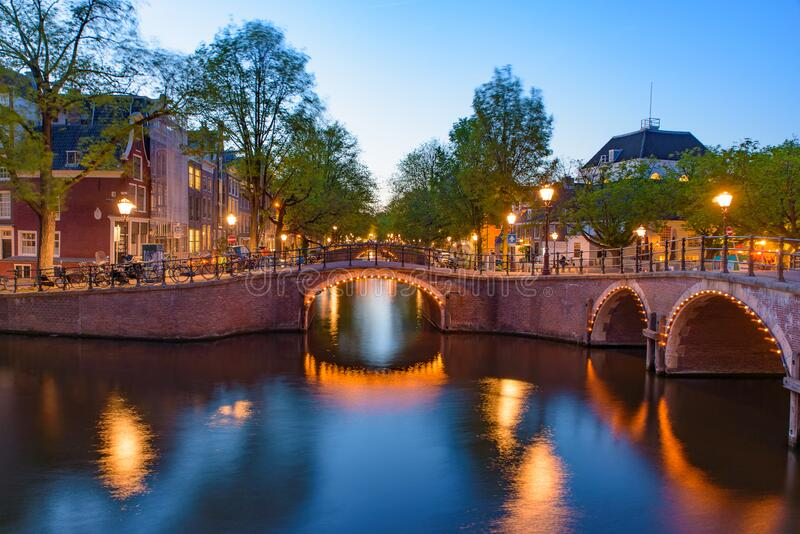 Reflection of bridge at night in Amsterdam, Netherlands stock photos