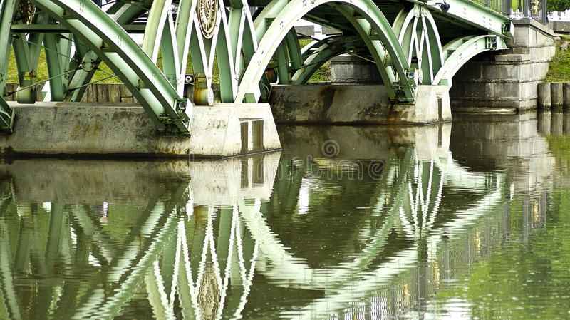 Reflection of bridge in water stock images