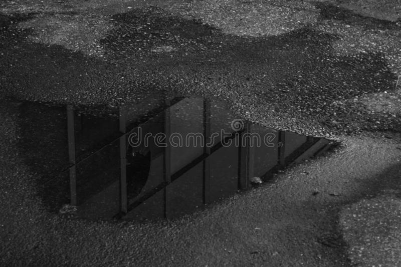 Reflection of a building in a puddle royalty free stock photo