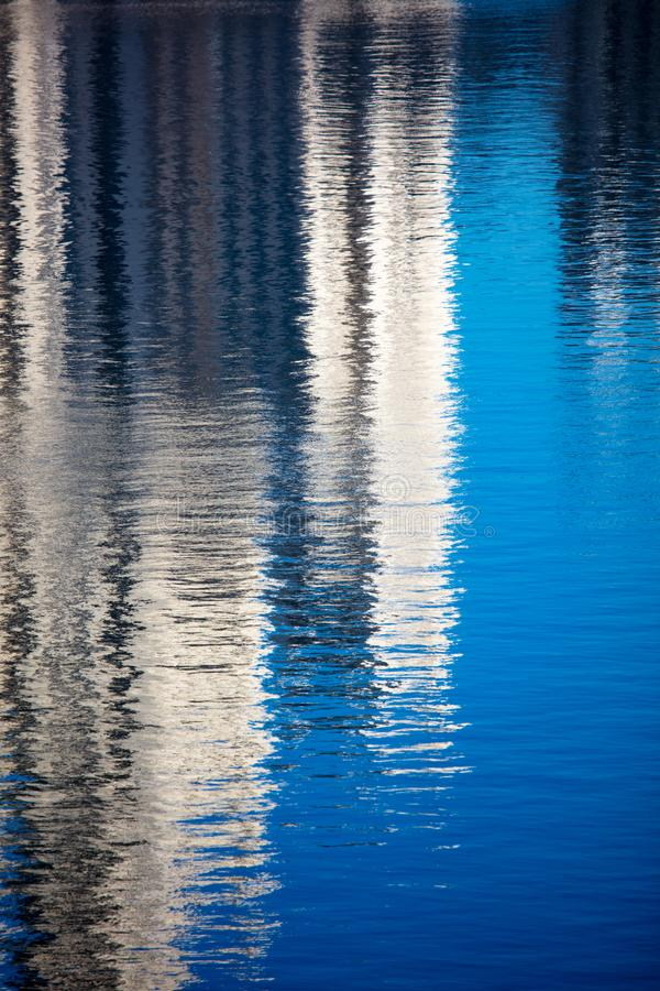 Reflection of a building on the smooth surface of water as a background stock photography