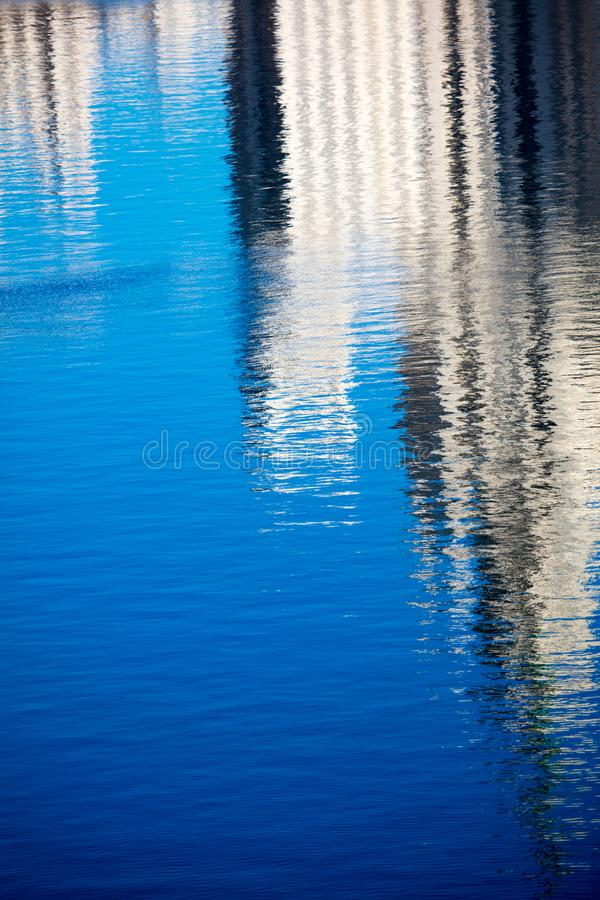 Reflection of a building on the smooth surface of water as a background royalty free stock photo