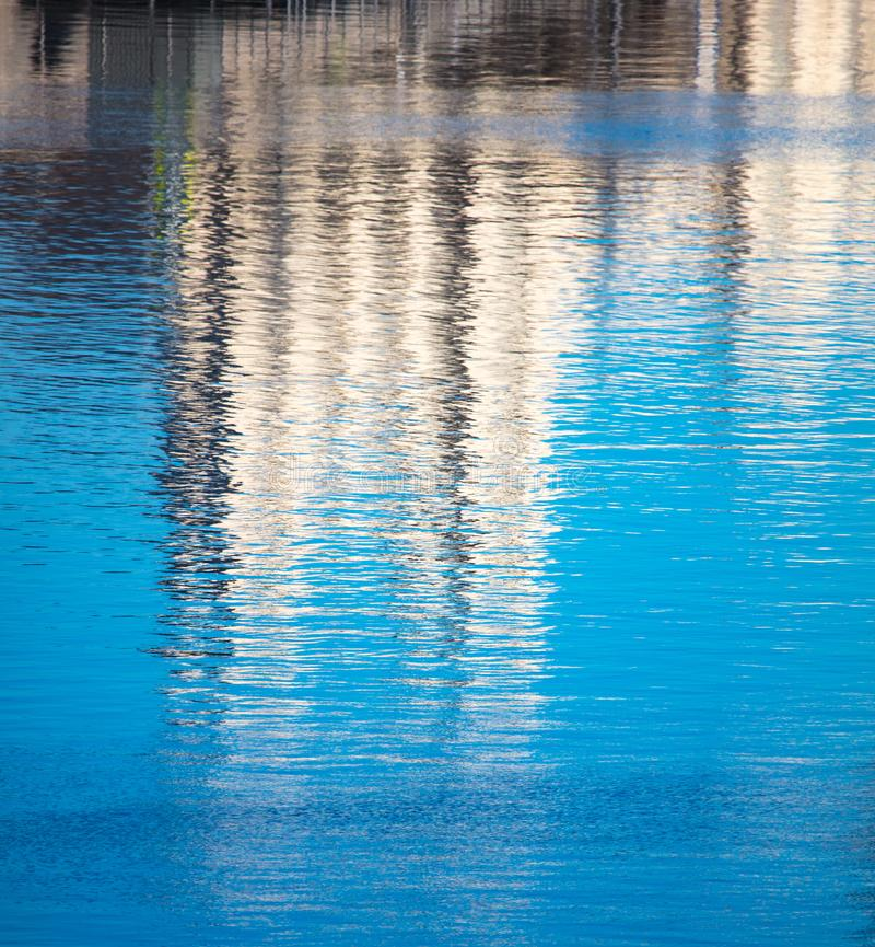 Reflection of a building on the smooth surface of water as a background royalty free stock photography