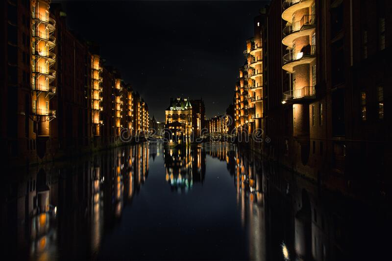 Reflection of Buildings on Water during Nighttime stock photo