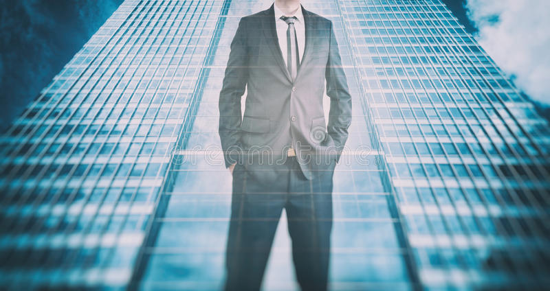Reflection of a businessman in modern skyscraper. Business leader, career growth royalty free stock images