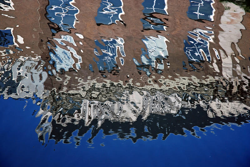 Reflection of canal houses, Amsterdam stock images