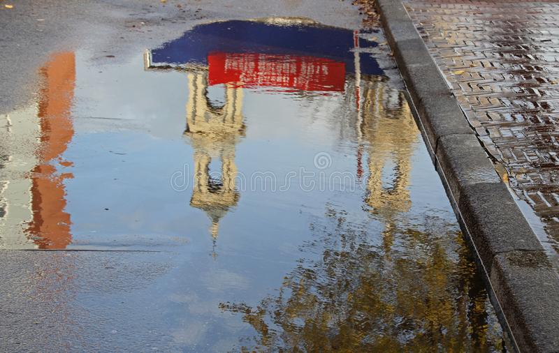 Reflection of the church in a puddle royalty free stock photography