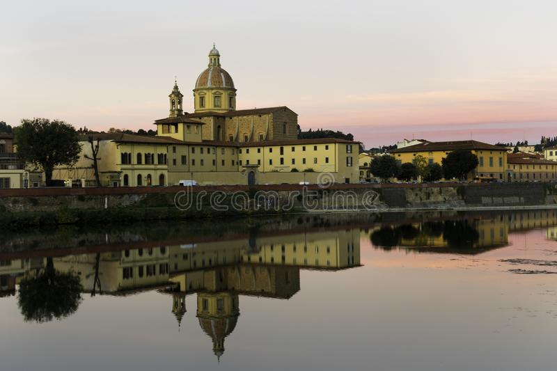 Reflection of the city Florence in the river. Italy stock photo