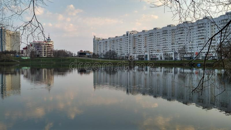 Reflection of a city street in the river surface Minsk Belarus. Europe, travel, building, architecture, water, urban, sky, landmark, outdoor, landscope, town royalty free stock photography