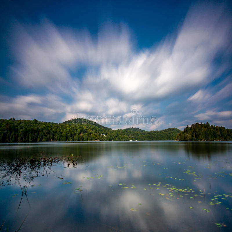 Reflection of the clouds going over a lake royalty free stock images