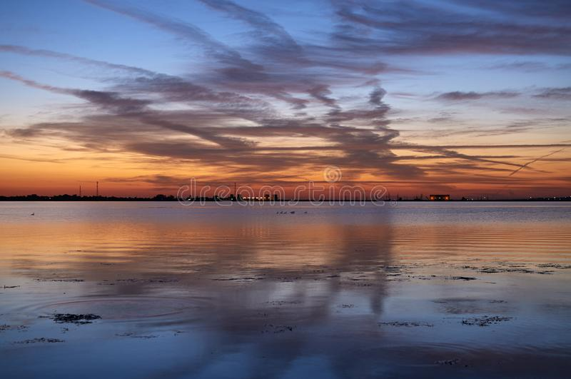 Reflection of clouds in a lake at sunset royalty free stock photos