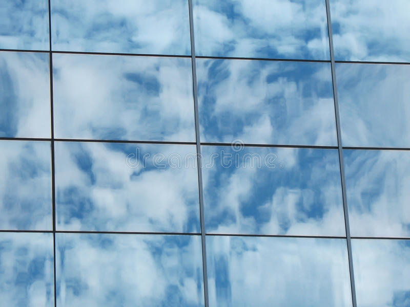 Download The Reflection Of The Cloudy Sky In The Glass Wall Stock Image - Image: 13565999