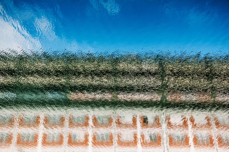 Reflection of coloured house on canal water royalty free stock images