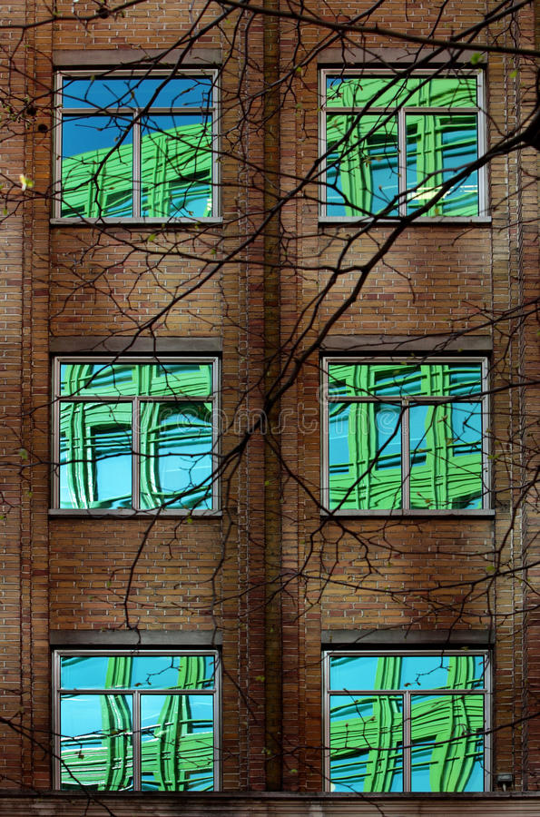 Reflection Of Colourful Building In Windows Stock Images