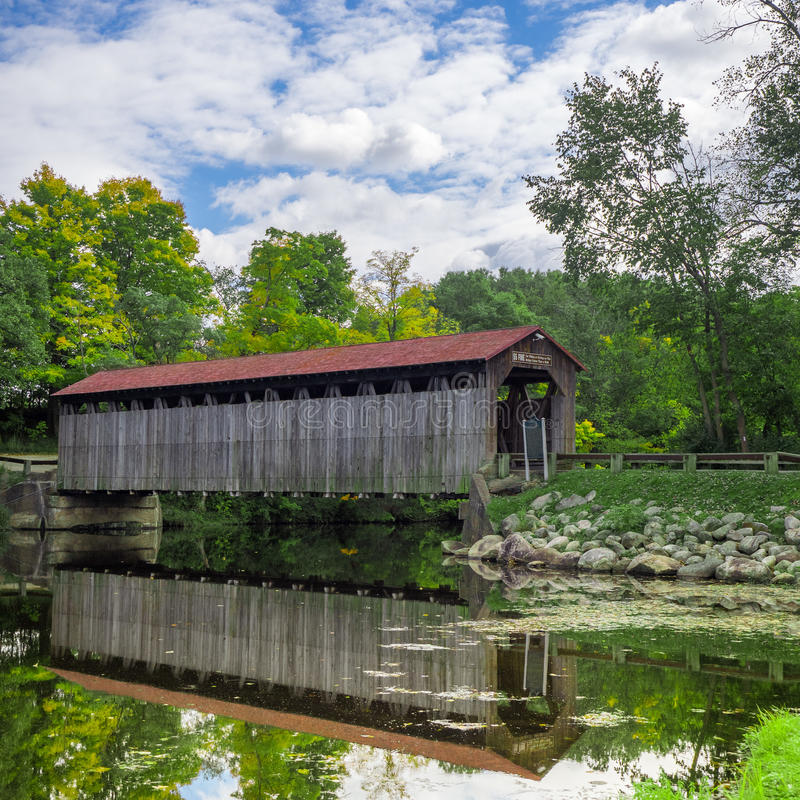 Reflection Covered. Fallasburg Bridge is a 100-foot span Brown truss covered bridge, erected in 1871 in Vergennes Township, Michigan, United States stock image