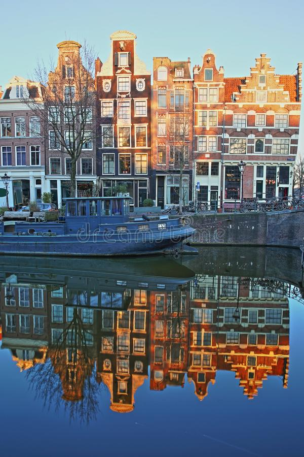 Reflection of crooked and colorful heritage buildings along Prinsengracht Canal and next to Brouwersgracht Canal, Amsterdam. Netherlands. Picture taken at royalty free stock photo