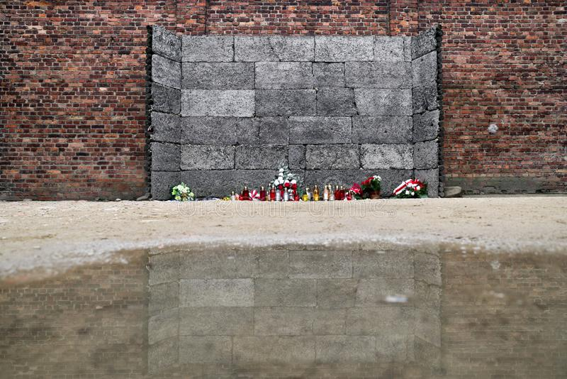The death wall at concentration camp in Auschwitz I, Poland. Reflection of the death wall at Concentration camp in Auschwitz I, Poland royalty free stock images