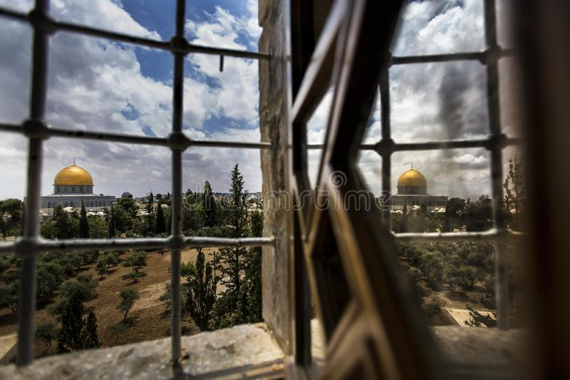 Reflection of the dome of the rock on the window stock photos