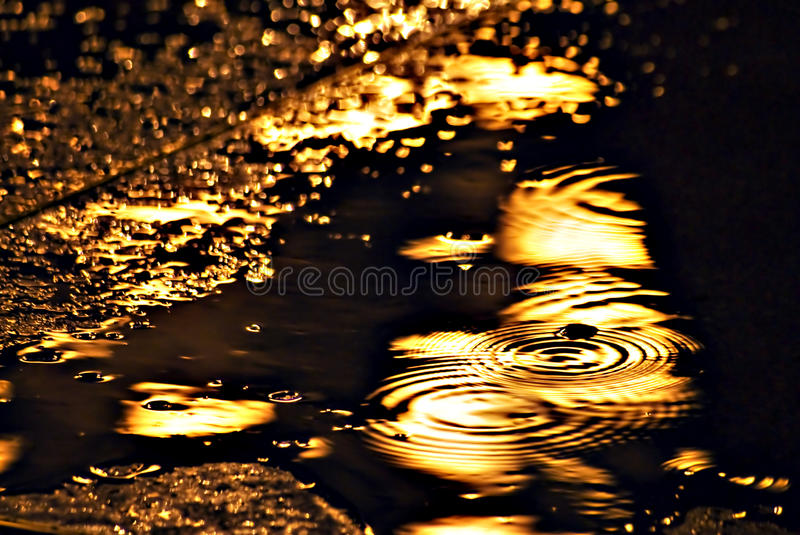 Download Reflection Of The Electric Light In The Rain Stock Photo - Image of plash, asphalt: 14496500