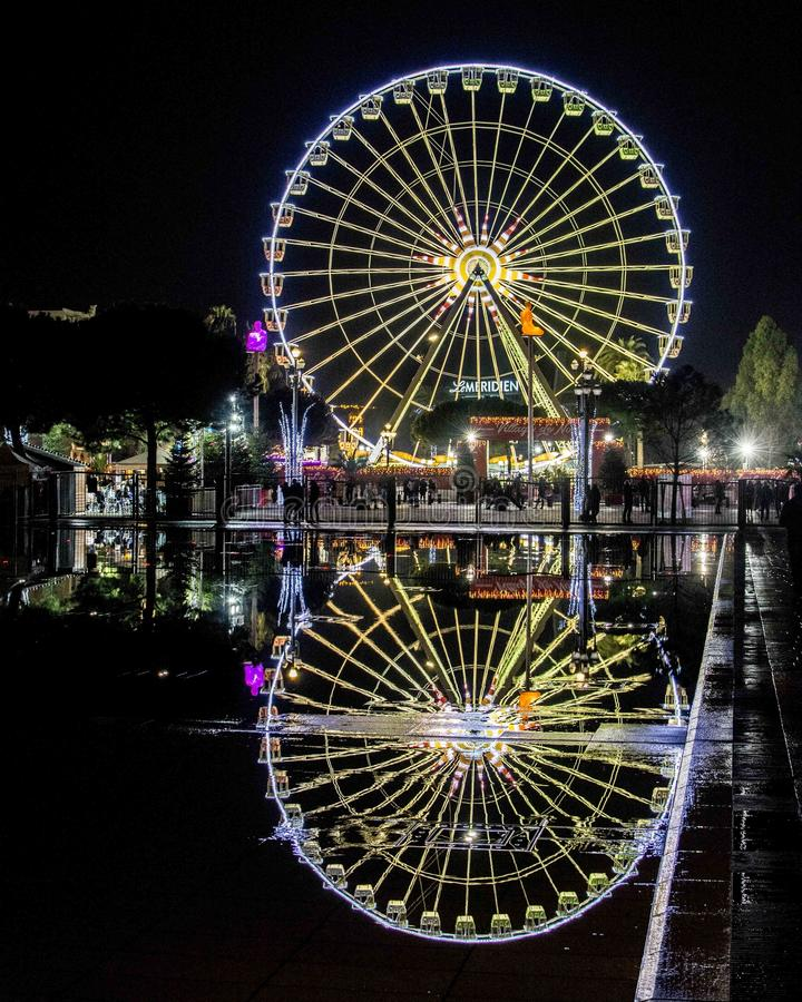 Reflection of Ferris Wheel in Nice stock images