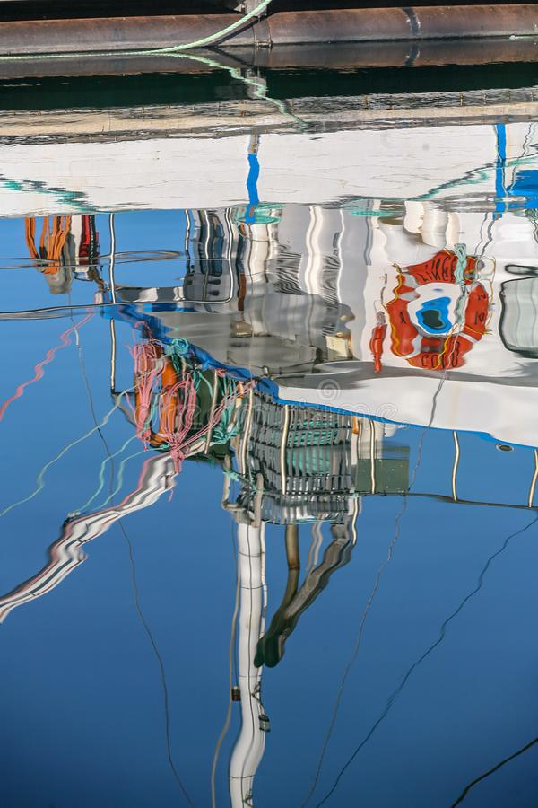 Reflection of a fishing boat stock photo