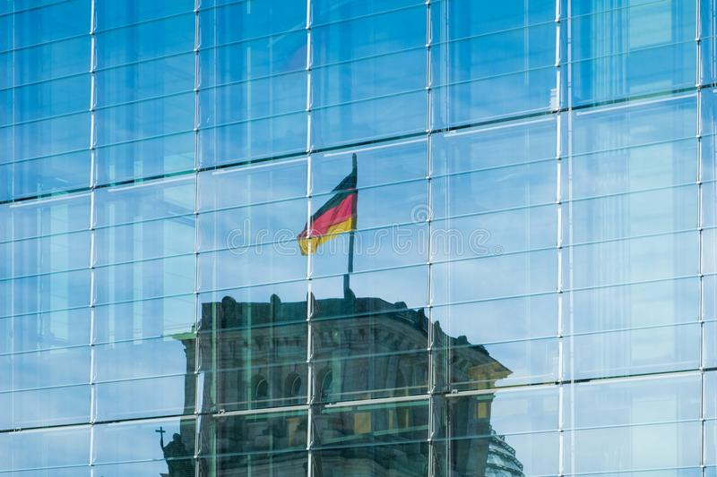 reflection of the german flag on Reichstag building in modern glass facade - royalty free stock photos