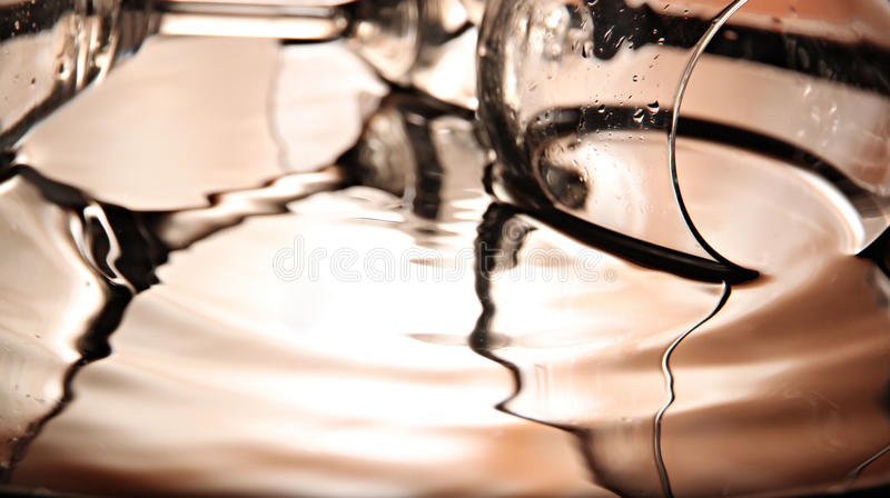 Reflection of the glass in the basin on Orange Background.