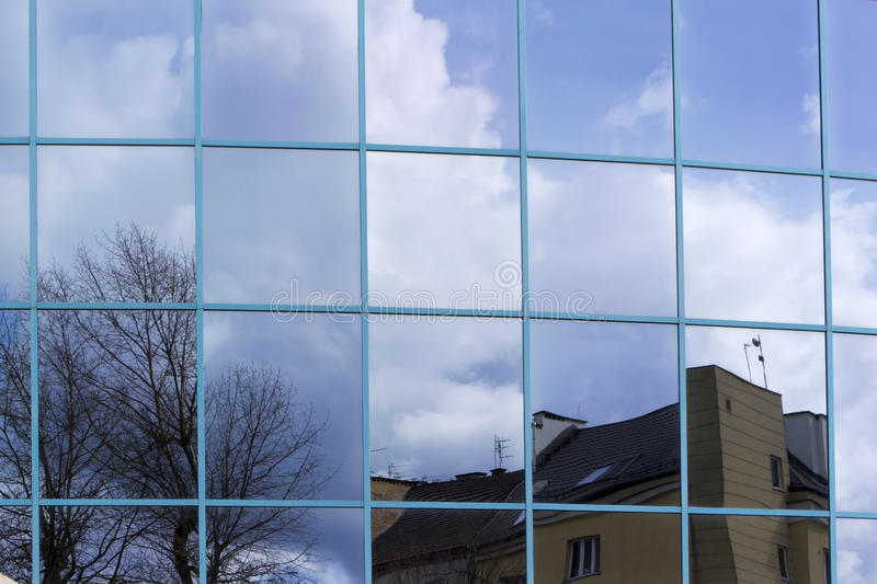 Reflection in glass windows of office building stock photography