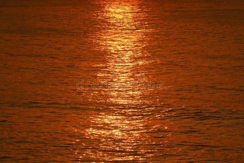 Reflection of glitter rising sun ray on the surface of Atlantic ocean, Copacabana Beach, Rio de Janeiro, Brazil. South America stock photos