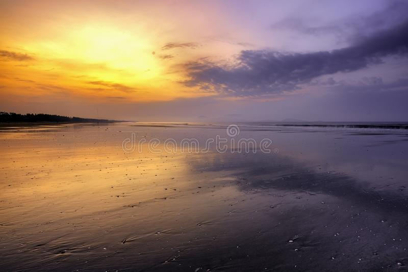 Reflection on gold beach in summer stock images