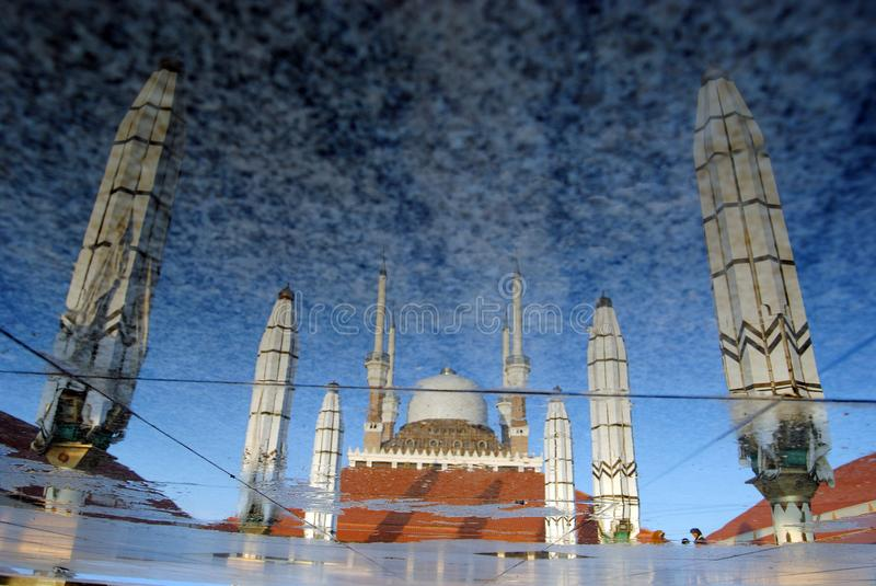 Reflection of Great Mosque of Central Java, Semarang, Indonesia. The mosque complex covers 10 hectares 25 acres. There are three central buildings arranged in stock images