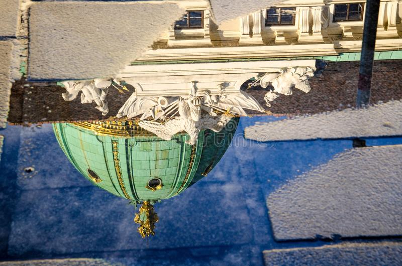 Reflection of Hofburg building dome in a puddle, Vienna, Austria royalty free stock photo