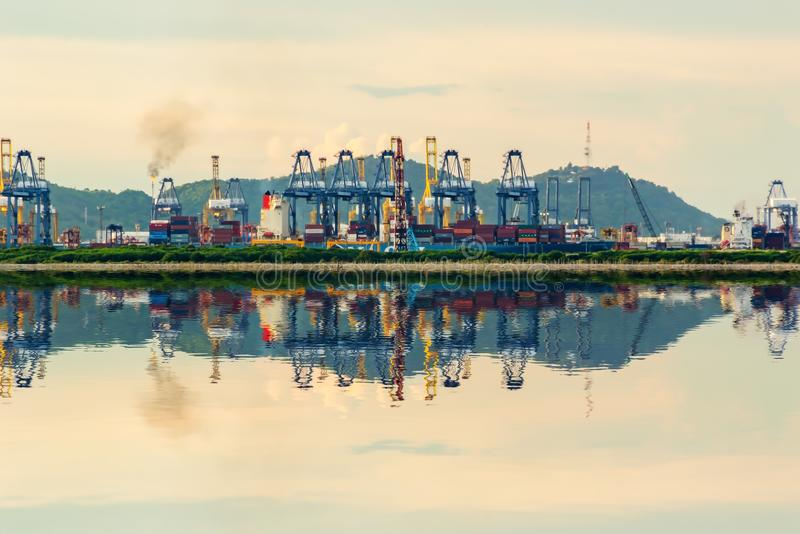 Reflection of Industrial Container Cargo freight shipping by crane Logistic Import Export. Reflection of Industrial Container Cargo freight shipping by crane stock photos