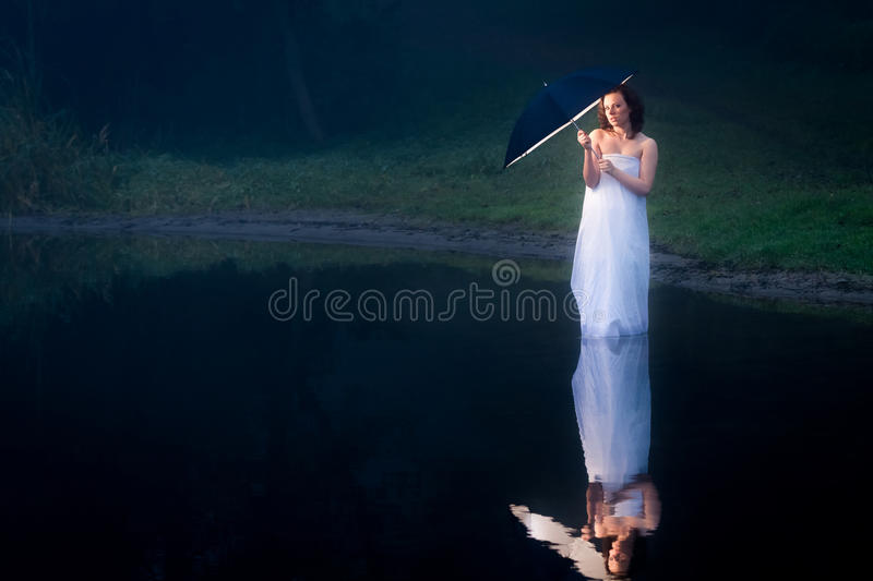 Reflection in the lake woman with umbrella royalty free stock images