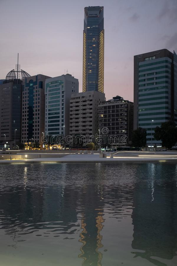 Reflection of Landmark tower abu dhabi in water at evening royalty free stock photo