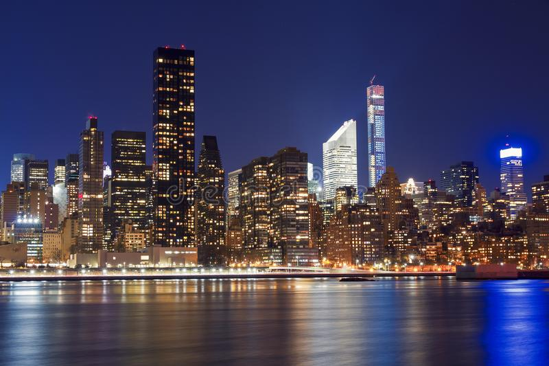 Reflection of Manhattan Skyline in Hudson River during blue hour stock photos