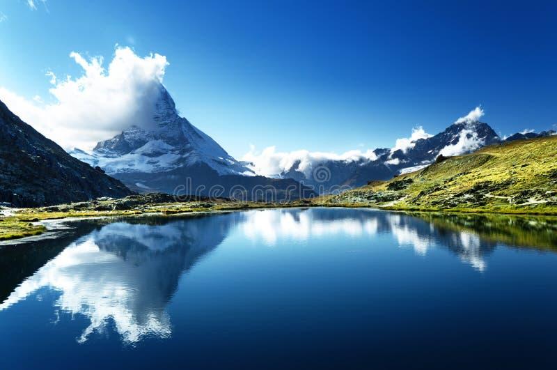 Reflection of Matterhorn in lake, Zermatt. Reflection of Matterhorn in lake Riffelsee, Zermatt, Switzerland royalty free stock photography