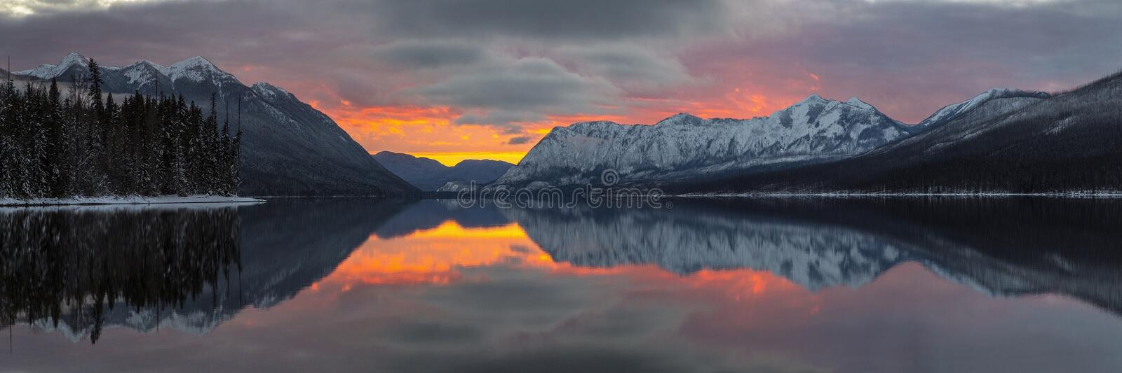 Reflection of Mountains in Lake during Sunset royalty free stock images