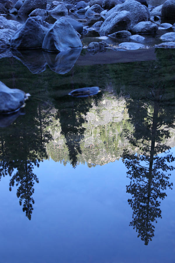 Reflection of Mountainside in Stream royalty free stock photos