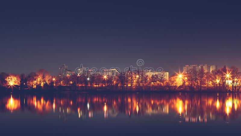 Reflection of night city in water of river.  royalty free stock photography
